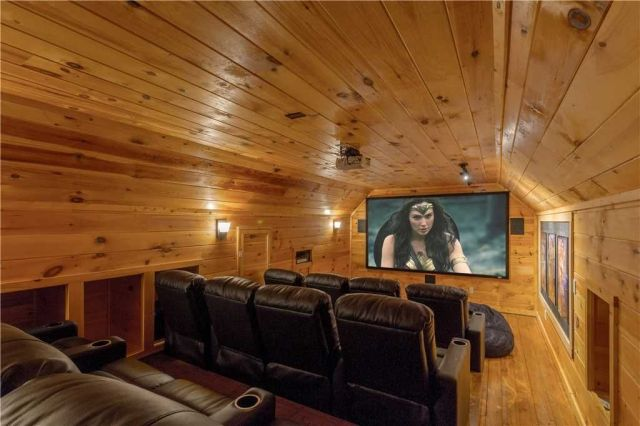 You'll never look at your local cinema the same way again - The home theater is equipped with a giant screen, multiple speakers, and generously padded reclining chairs. Don't forget the popcorn!
