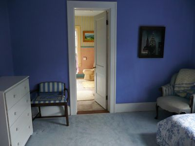 A bedroom with adjoing bath