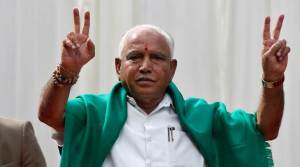 India's ruling Bharatiya Janata Party (BJP) leader B. S. Yeddyurappa flashes the victory sign after taking oath as Chief Minister of the southern state of Karnataka inside the governor's house in Bengaluru, India, May 17, 2018. REUTERS/Abhishek N. Chinnappa