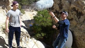 Sound designer Rudy and a boom mic