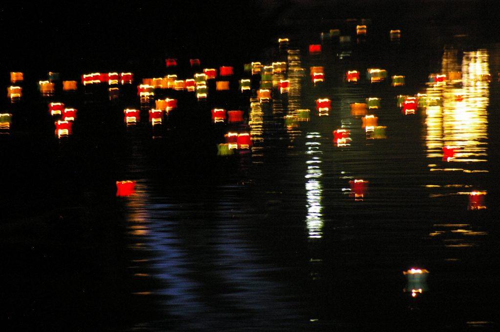 lighted lanterns on the river