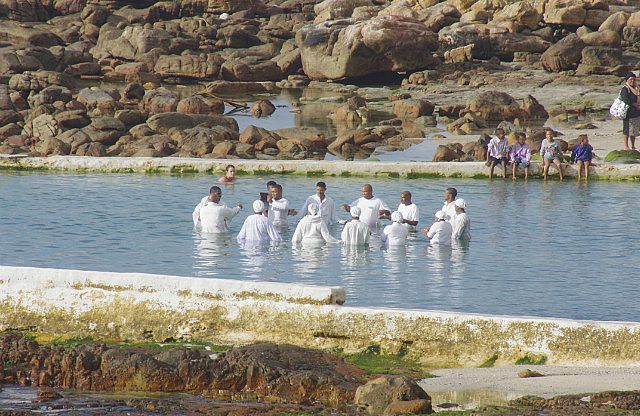 Sunday morning baptism in the tidal pool