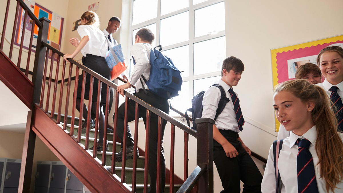 Children in a school in the United Kingdom walking up a staircase to their classrooms