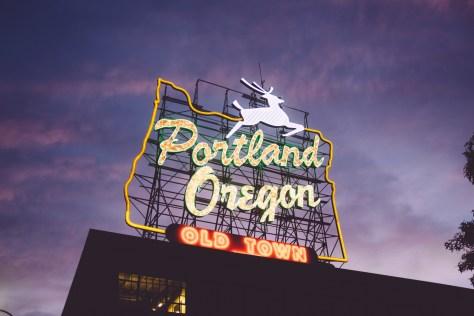 Neon Portland Oregon Sign on brick building at dusk
