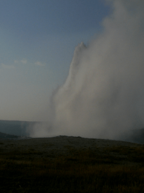 Old Faithful hot water geyser spurts water in its 3 to 4 minute activity until it goes dormant for the next hour or so.