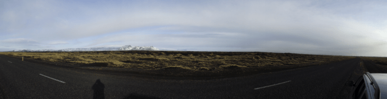 A panorama including the road, facing north to Vatnajokull between Vik and Skaftafell. The road was often so empty we could have stopped in our lane to get out and take photos.
