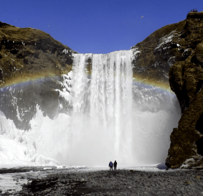 skogafoss-waterfall-rainbow-iceland-winter