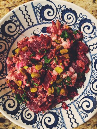 Scrambled Brains with Beets, garnished with parsley and pistacios