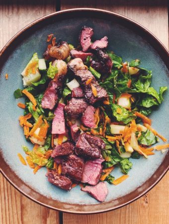 Grilled beef heart over a simple romaine salad