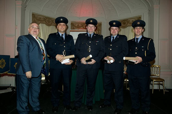 Ceann Comahirle Séan Ó Fearghaíl with National Bravery Award winners (L-R) Garda Mark Holden, Garda John Hennessy, Garda J.P O'Sullivan and Garda Alan Hayes. Photo: Lensmen