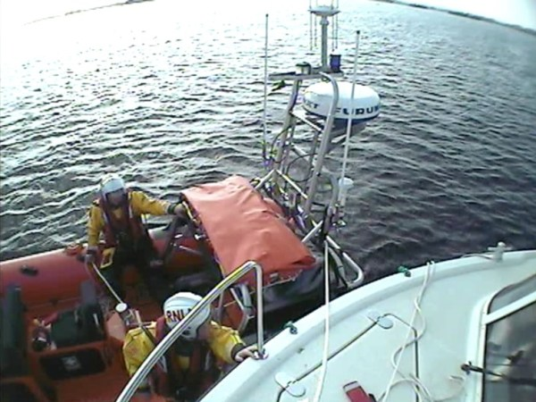 Lough Derg RNLI launch to assist 4 adults and 3 children on a 60ft vessel aground in Coose Bay