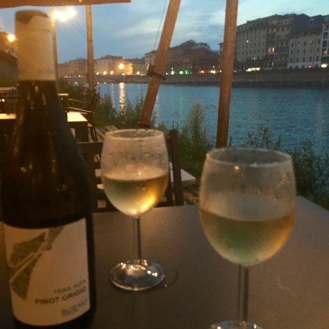 Italian wine and dinner on the River Arno in Pisa Italy