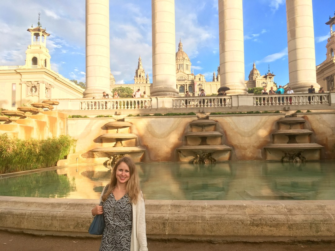 Girl standing in front of Magic Fountain and Plaça de les Cascades