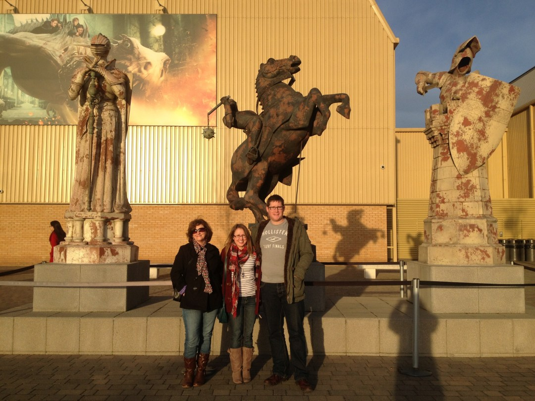Visitors pose outside Entrance Harry Potter studio tour in front of giant chess pieces