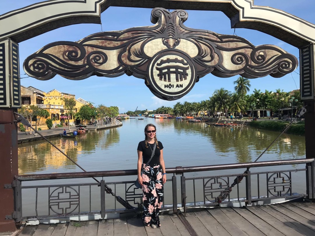 Girl in floral trouser on bridge in Hoi An