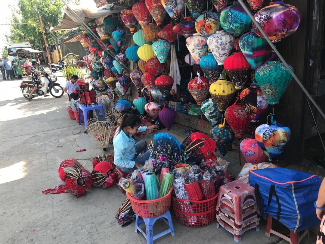 Street vendor making silk lanterns in Hoi An Ancient Town Vietnam