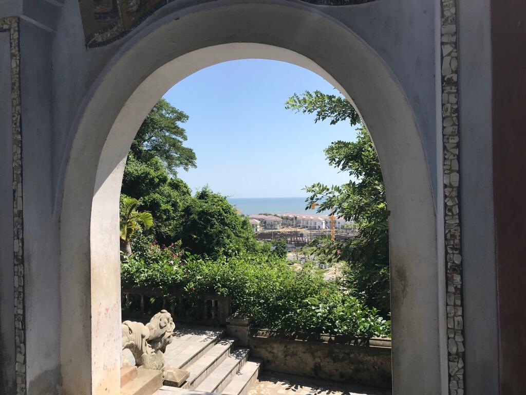 Through an archway in the Marble Mountains