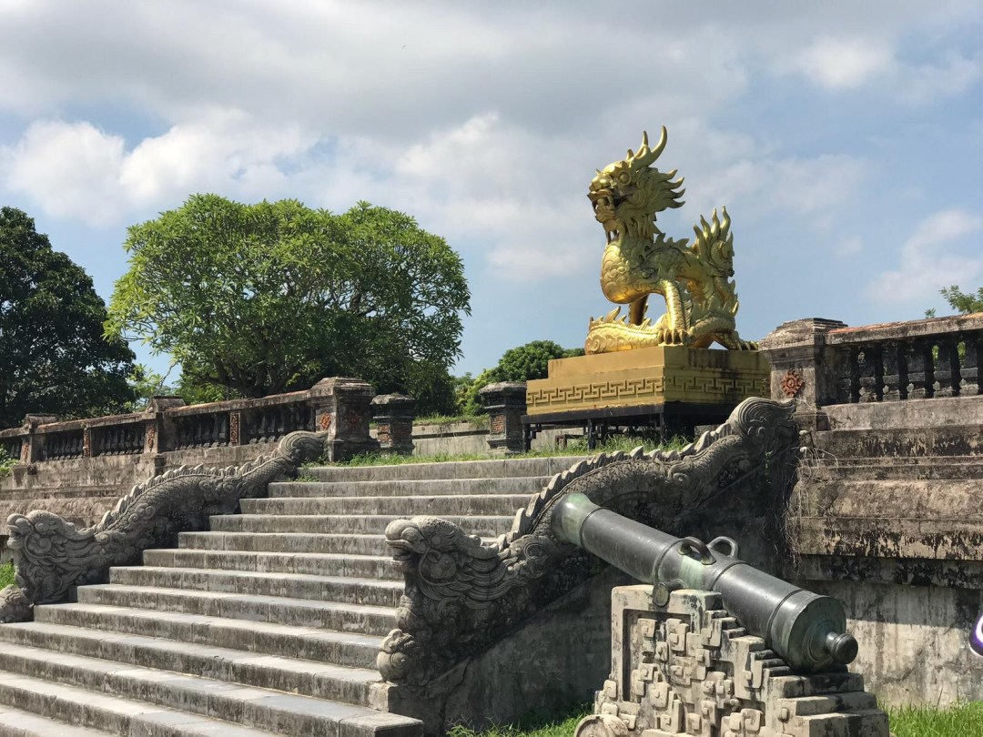 Golden Dragon statue and canon in Hue Imperial City