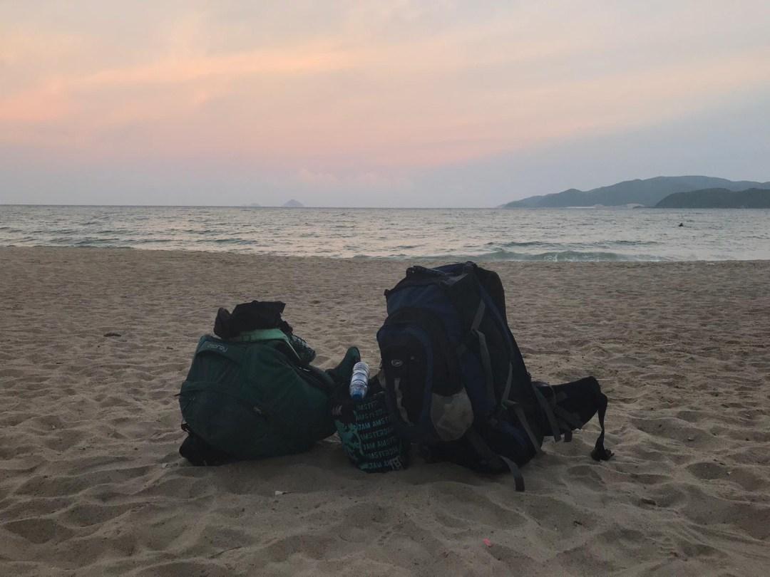 backpacks on beach at sunset in Nha Trang Vietnam