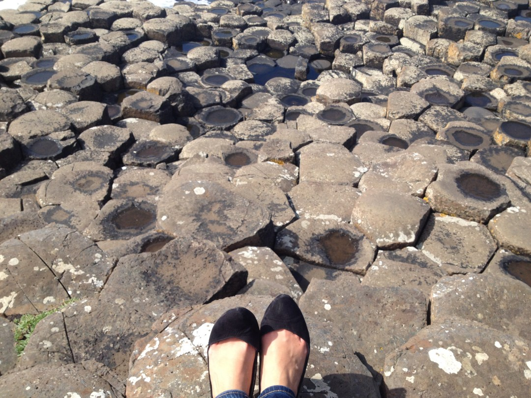 Shoes on hexagonal rocks of Giant's Causeway