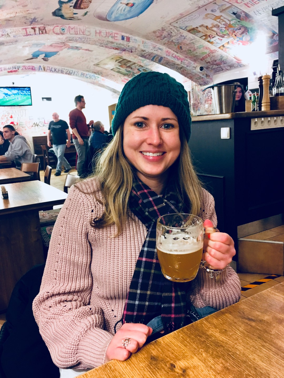 travel blogger with beer on Prague beer tasting tour in Czech bar