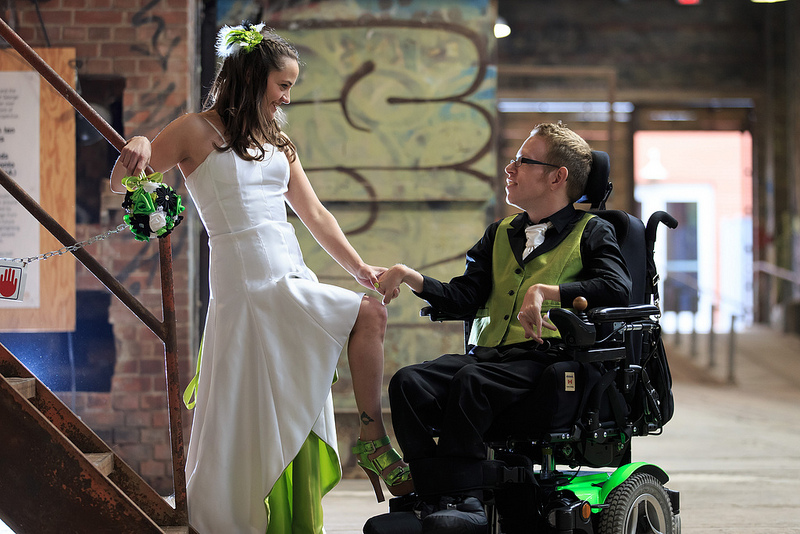 Photo of Tim rocking Iz Adaptive clothing at his wedding as seen on Offbeat Bride.