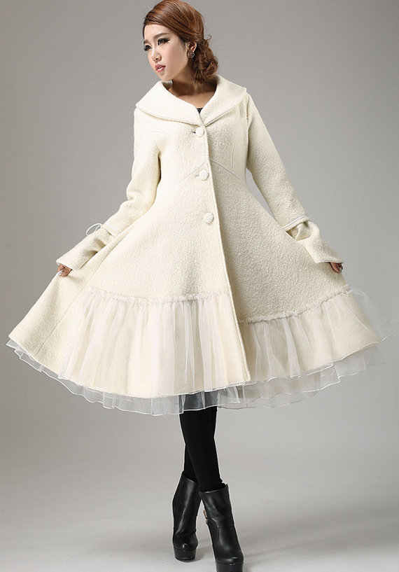 Loving this knee-length white winter jacket from Etsy seller xiaolizi.