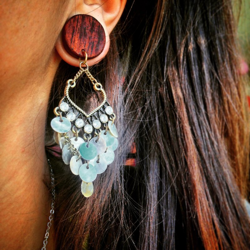 Loving the dangle on these wooden bridal plugs.