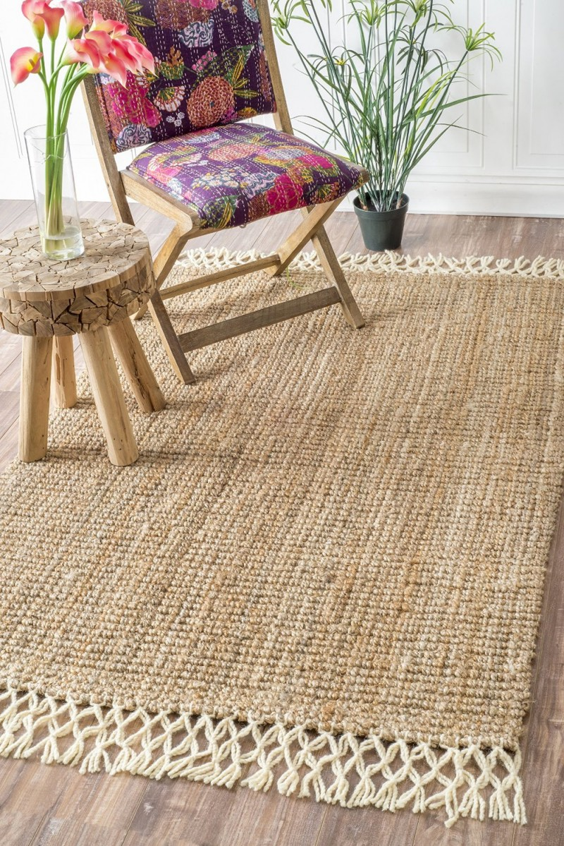 Use a rug (I like this Natural Fibers Hand-Woven Fringe Natural Area Rugs) for your ceremony, and then use it in your home forever afterwards!