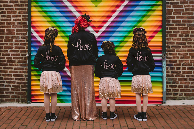 This rad pop-up wedding had glitter, sequins, and huge rainbow mural LOVE