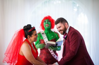 The Rev D dressed as Miss Argentina from Beetlejuice in an wedding featured on Offbeat Bride!