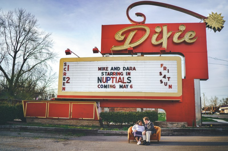 Retro cars, popcorn, & an adorable pair at this vintage drive-in movie engagement session