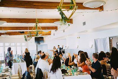 Two ladies, air plants, and Dr. Seuss at this modern boho wedding on Lake Michigan