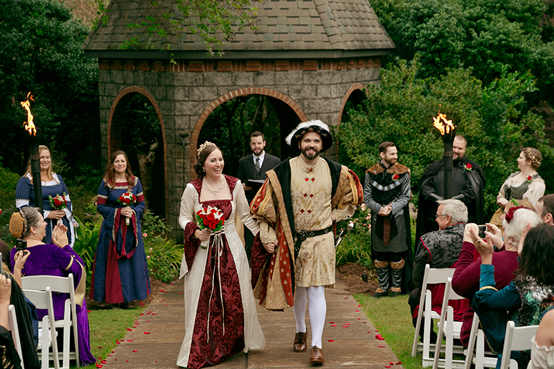 A costumed royal Renaissance affair with a sword in the stone cake(!)
