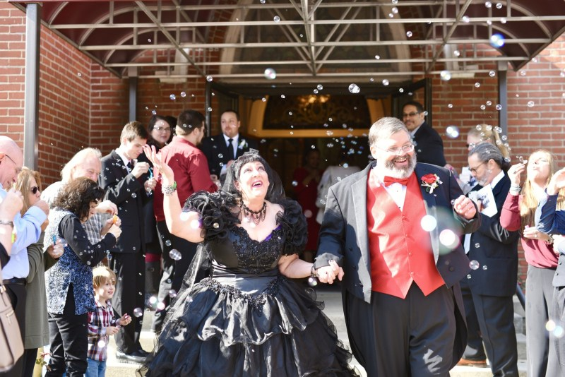 This bride bought her black dress 30 year ago and finally got to wear it at her spooktacular wedding