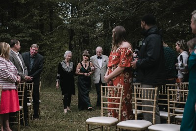 A crystal ball in the woods at this creative & sustainable wedding with intention