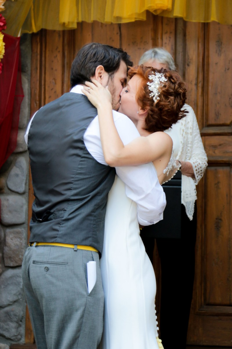 Pops of color, fave fandoms, & vegan food at this Enchanted Manor wedding