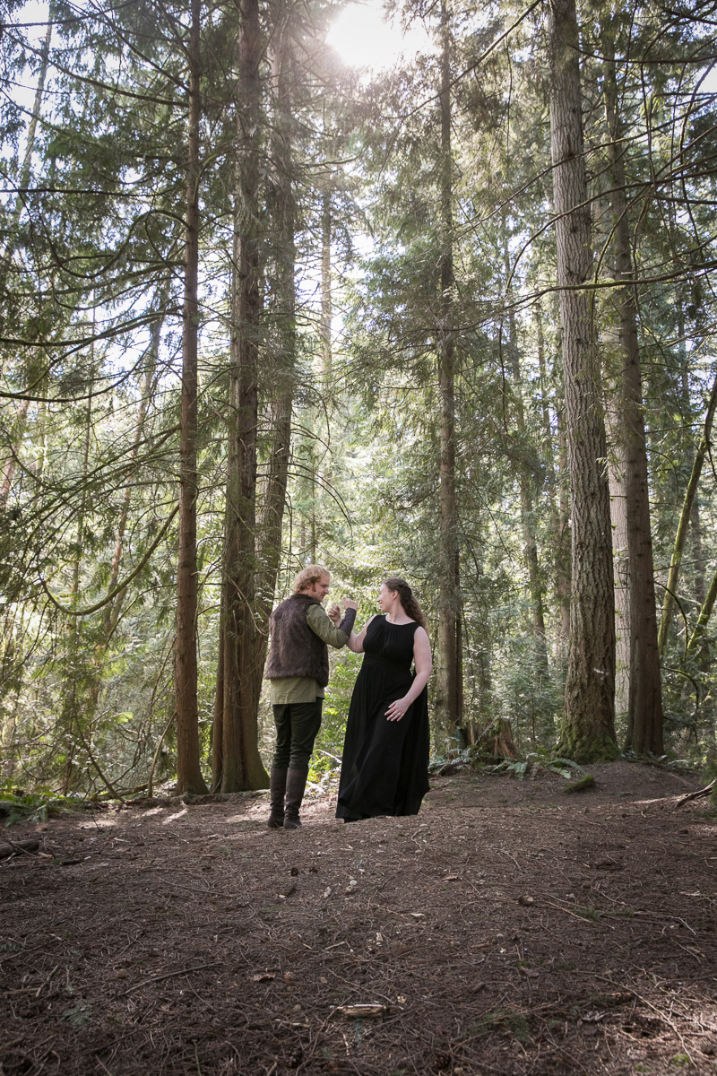 This pair met Toothless at their How to Train Your Dragon-themed forest engagement shoot
