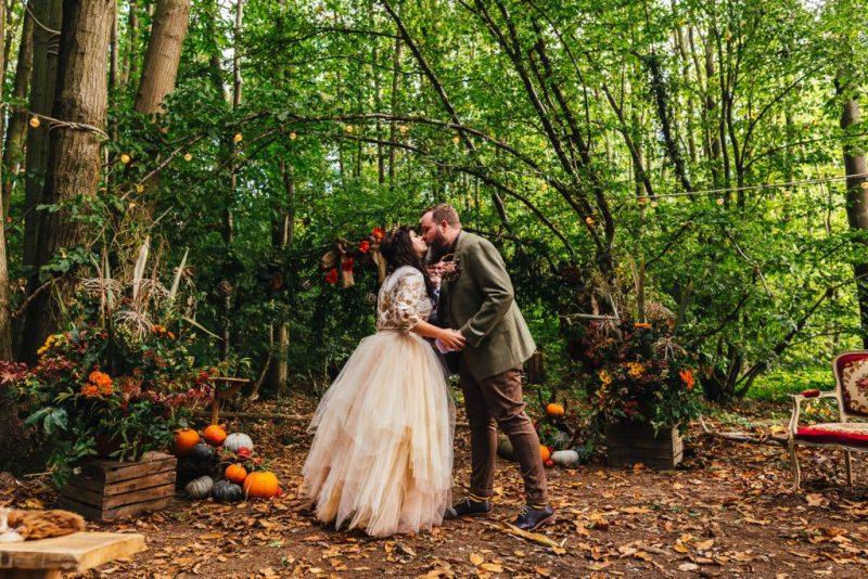 A wild woodland Halloween wedding in Kent with smoke grenades, pumpkins, & an Irish band
