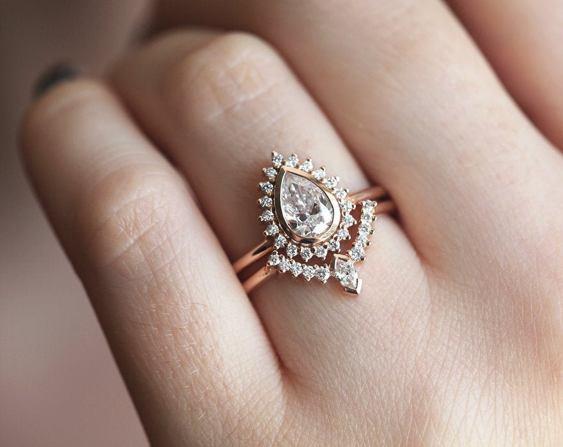 pear diamond ring on offbeat bride