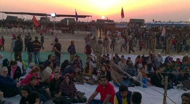 Tourists sitting on the ground to watch the show at Desert Festival Jaisalmer in Rajasthan (India), an annual festival held in the desert. Jaisalmer travel blog about this Rajasthan Festival, dances and places to visit in Jaisalemer rajasthan