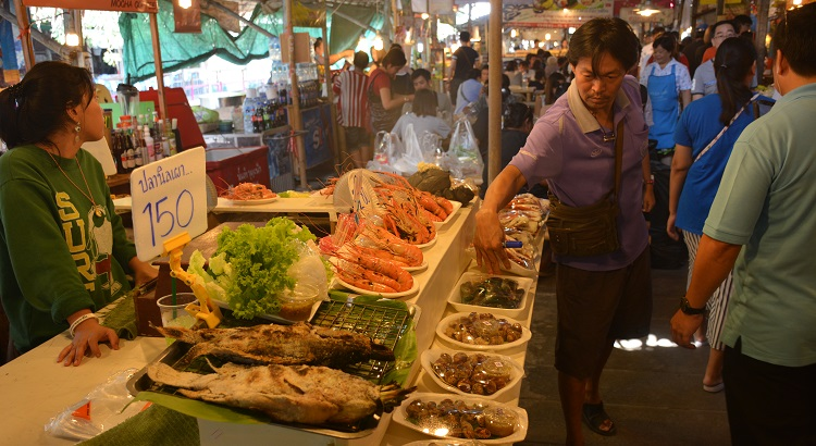 Try famous Thai Pla Pao dish - Grilled salt crusted fish