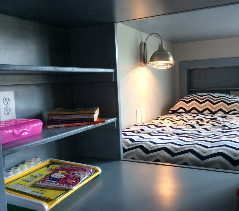 shelf and crawlspace between the beds