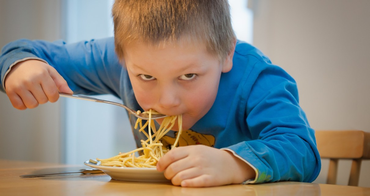 kid eating a bowl of noodles