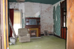 Living room. Original fireplace, brick walls, lots of original woodwork.