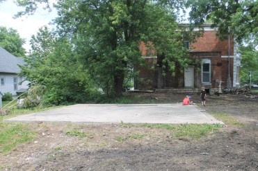 Photo of the old garage site from the alley behind the house.