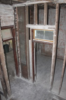 Another look into the downstairs bedroom (doorway on the right) and into the dining room (doorway on the left)
