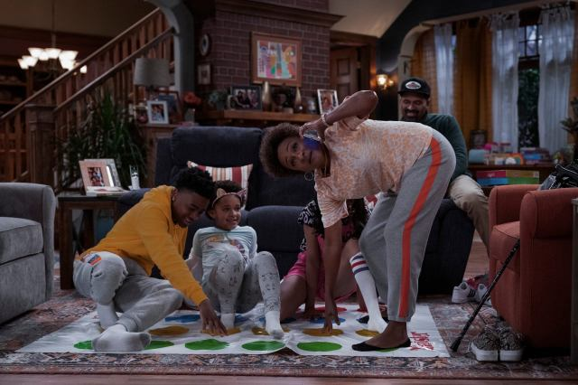 The Upshaws still showing the kids playing twister with Lucretia.