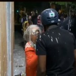 Rioters attack older woman
