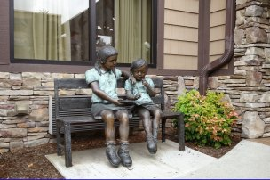 Sculptures of kids at the entrance.